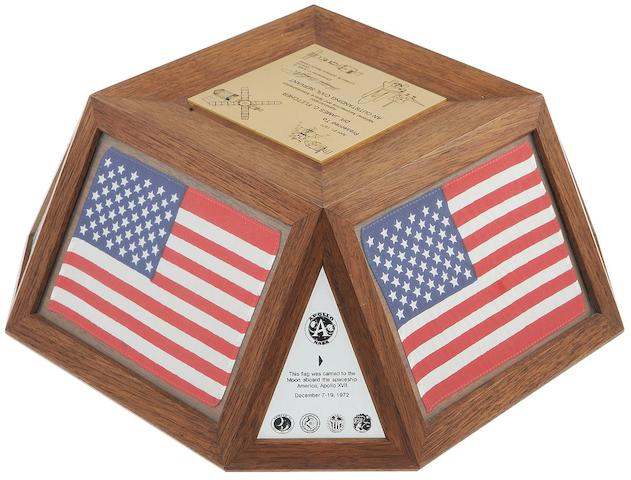 APOLLO'S TOP LEVEL AWARD WITH FLOWN FLAGS. Desktop presentation from Johnson Space Center Director Chris Kraft to NASA Administrator Dr. James C. Fletcher, comprising three flown flags, each 4 x 6 inches, and accompanying plaques. Mahogany, the flags behind lucite panels.