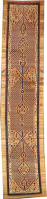 A Serab runner  Northwest Persia size approximately 3ft. 9in. x 16ft. 6in.