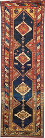 A Kurdish runner  Northwest Persia size approximately 3ft. 5in. x 11ft.
