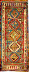 A Kazak rug  Caucasus size approximately 3ft. 5in. x 8ft. 2in.