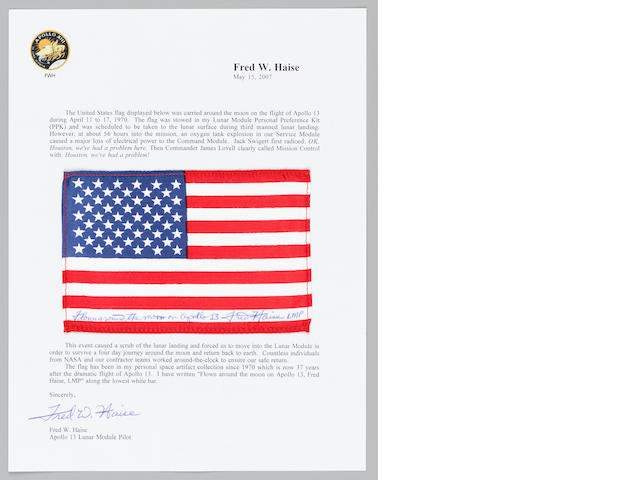 STARS AND STRIPES PLANNED BY FRED HAISE TO BE TAKEN TO THE LUANR SURFACE ON APOLLO 13.