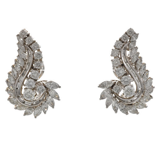 A pair of diamond scroll earrings