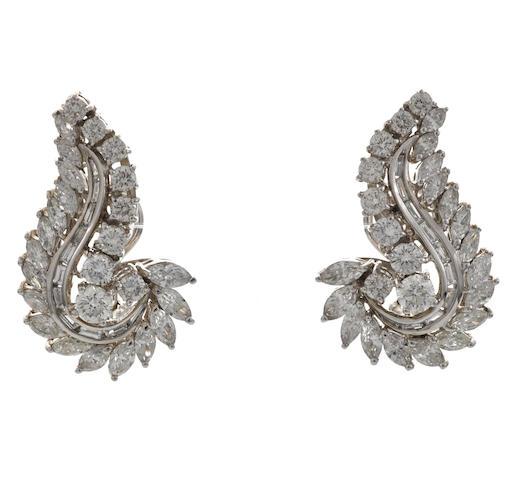 A pair of diamond scroll earrings