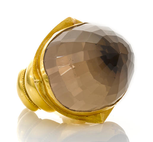 A smokey quartz and high karat gold ring