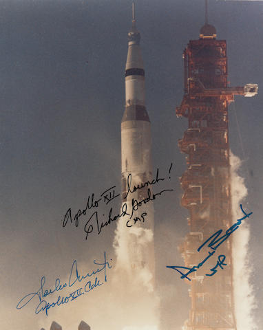 LIGHTING DOES STRIKE THE SAME PLACE TWICE – AT THE APOLLO XII SATURN V. CREW SIGNED APOLLO XII LAUNCH PHOTOGRAPH.