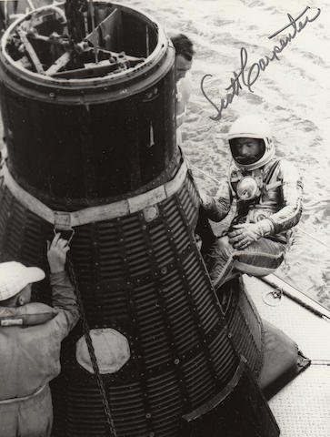 CARPENTER EXITS THE MERCURY SPACECRAFT.