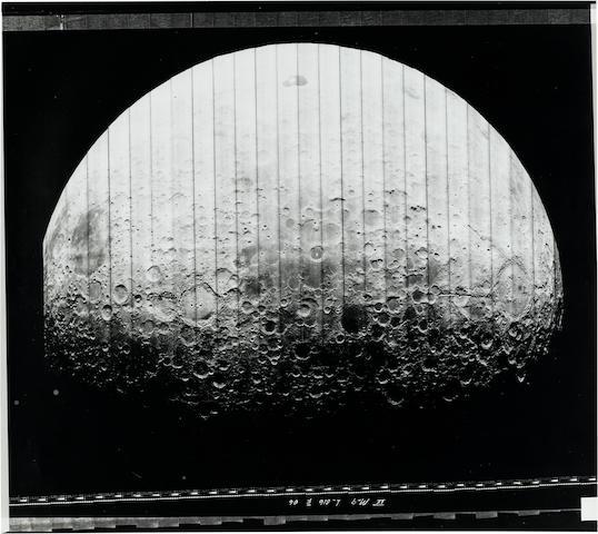 LUNAR ORBITER IV. ENTIRE LUNAR DISC, WITH TSIOKOVSKY CRATER AT CENTER.