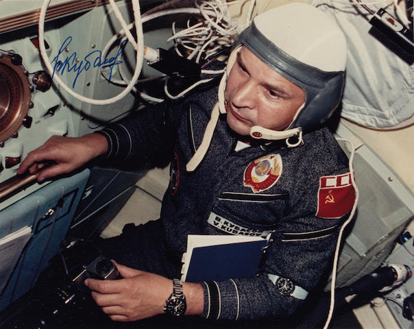 PERFORMING EXPERIMENTS AFTER THE FIRST INTERNATIONAL HAND-SHAKE IN SPACE.