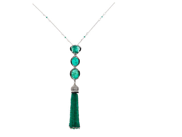An emerald, diamond and black onyx tassel pendant/enhancer with a white topaz and emerald longchain necklace