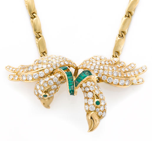 An emerald and diamond double bird pendant/enhancer with chain