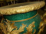 An imposing pair of Belle Époque style gilt bronze and malachite urns on Neoclassical style parcel gilt painted pedestals