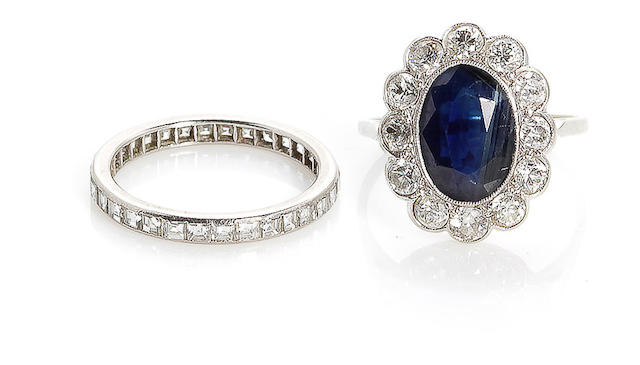 A sapphire and diamond ring together with a diamond eternity band