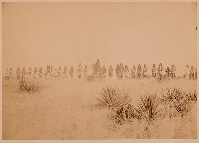 "GERONIMO. 1829-1909. Albumen print photograph, 6 5/8 x 9 1/2 inches, Tombstone, Arizona, 1886, mounted to cardstock, titled ""Geronimo and his Warriors"" on verso label,"""