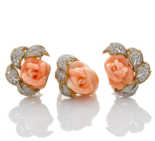 A carved coral and diamond rose ring together with a pair of matching earrings