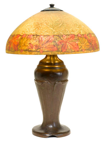 A Handel reverse painted glass and patinated metal Ivy border lamp early 20th century