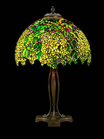 A Tiffany Studios Favrile glass and patinated bronze Laburnum table lamp circa 1910