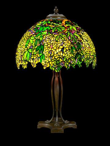 A Tiffany Studios Favrile glass and patinated bronze Laburnum table lamp circa 1910