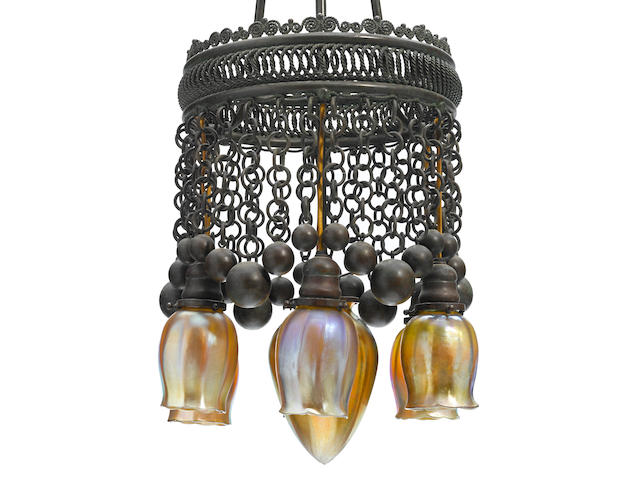 A Tiffany Studios patinated bronze and Favrile glass Moorish seven light chandelier 1899-1918