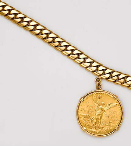 An 18k gold bracelet suspending a gold coin charm