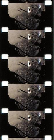 FLIGHT FILM OF ARMSTRONG AND ALDRIN RAISING OLD GLORY ON THE MOON. EAGLE RETURNS SAFELY FROM LUNAR SURFACE.