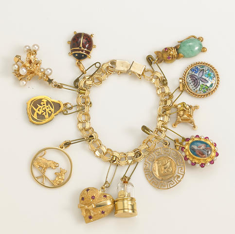 A 14k gold charm bracelet suspending eleven enamel, cultured pearl, gem-set and 14k gold charms