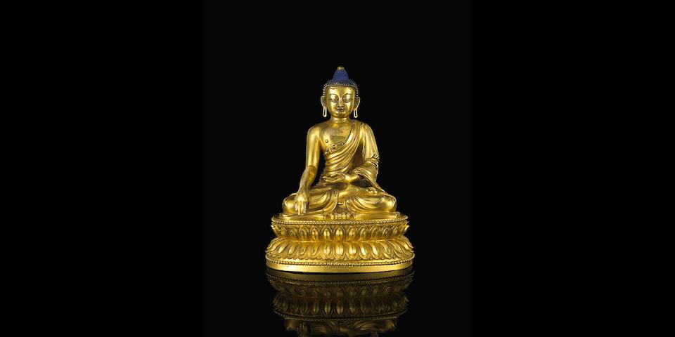 A gilt bronze seated figure of Buddha  Yongle six-character mark