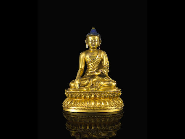 A gilt bronze seated figure of Buddha  Yongle six-character mark