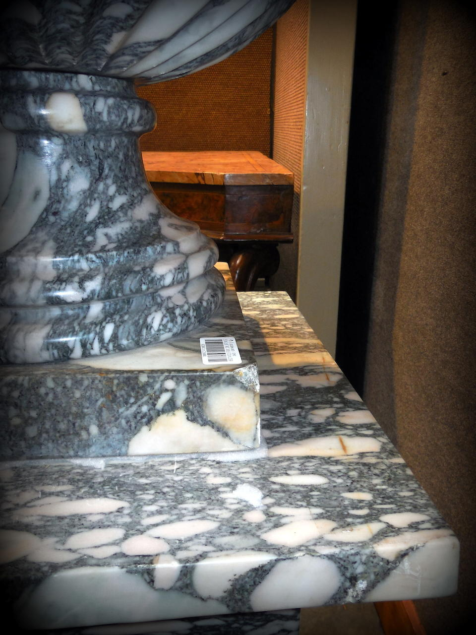 A pair of Baroque style white, gray and green marble urns on pedestals20th century