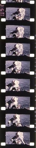 "APOLLO 16 MOTION PICTURES AND THE LUNAR ROVER ""GRAND PRIX."" LUNAR SCENES FROM THE ROVER AND A DEEP SPACE EVA TO RETRIEVE CAMERA FILM."
