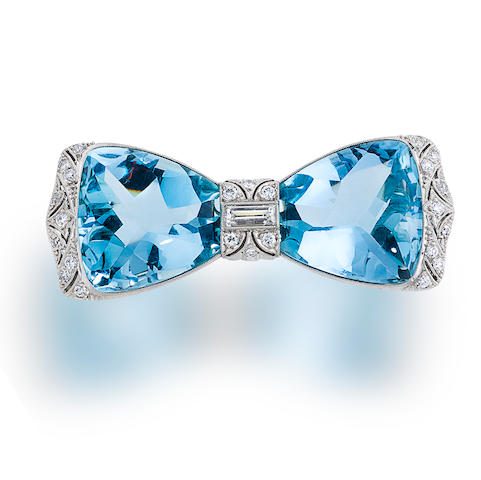 A belle époque aquamarine and diamond bow brooch,  J. E. Caldwell,