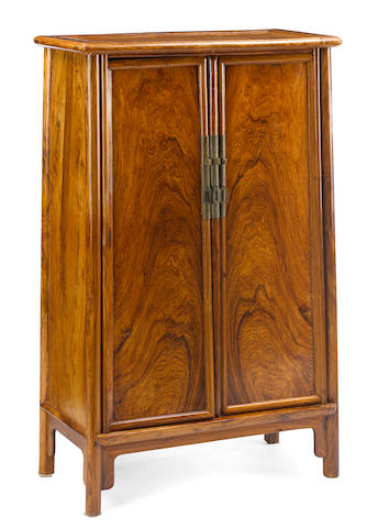 A hardwood rounded-corner tapered cabinet