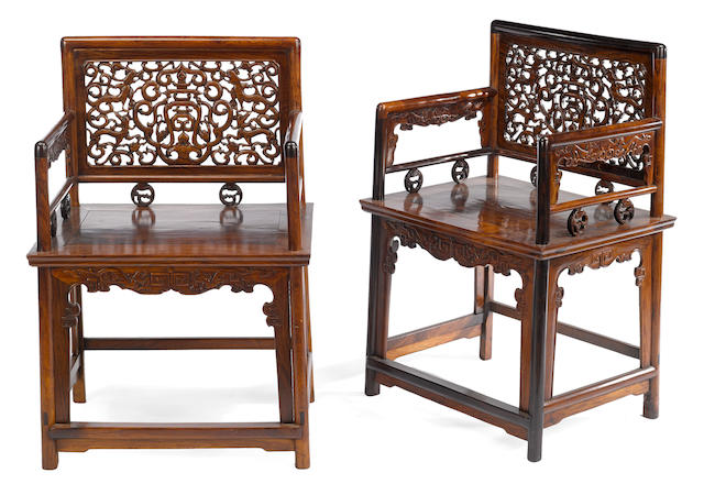 A pair of hardwood low-back 'rose' chairs