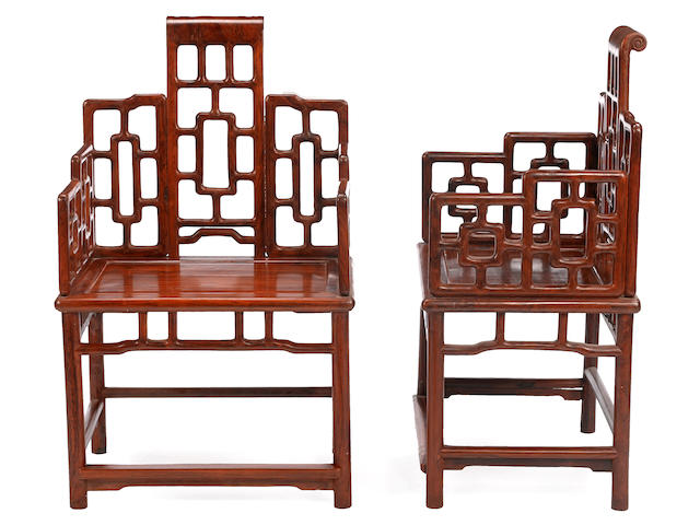 A pair of hardwood chairs