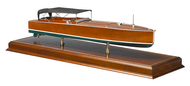 A Mahogany boat model with canvas roof,