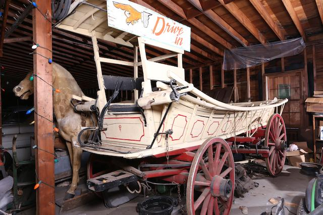 A Conestoga Horse Drawn Wagon,
