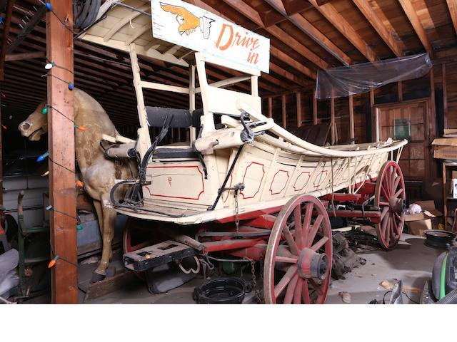 A Conestoga Horse Drawn Wagon,
