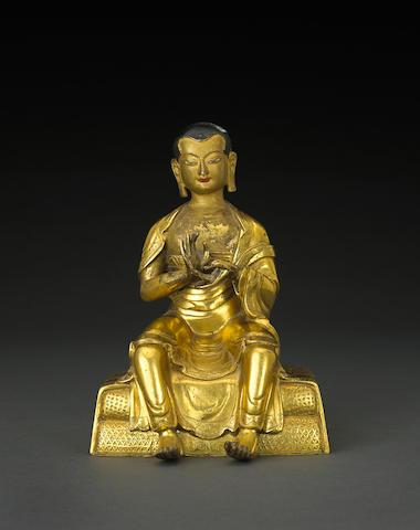 A gilt bronze figure of an Arhat  18th/19th century