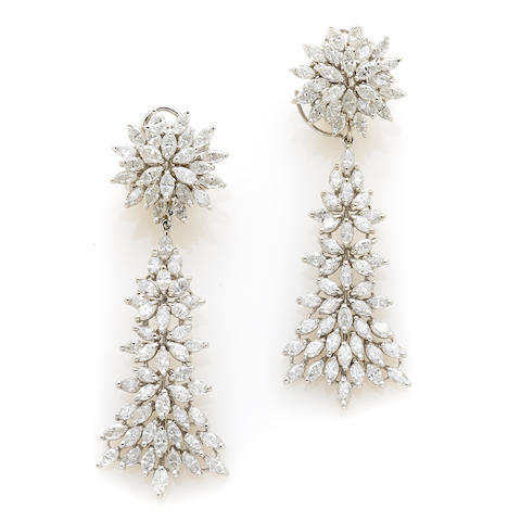 A pair of diamond and white gold day-night earrings