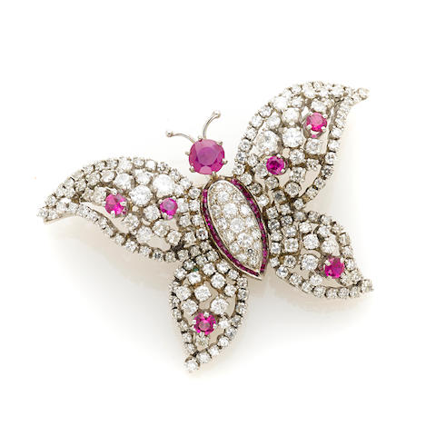 A diamond, red stone and white gold butterfly pendant