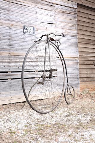 An unrestored highwheeler bike,
