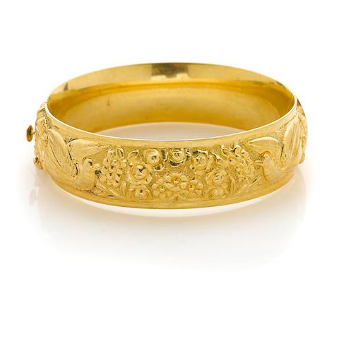 A gold embossed bangle bracelet