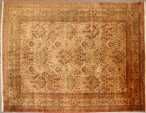 An Indo Tabriz size approximately 6ft. 11in. x 9ft. 5in.