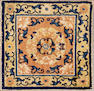 A Chinese rug  size approximately 1ft. 11in. x 2ft. 1in.