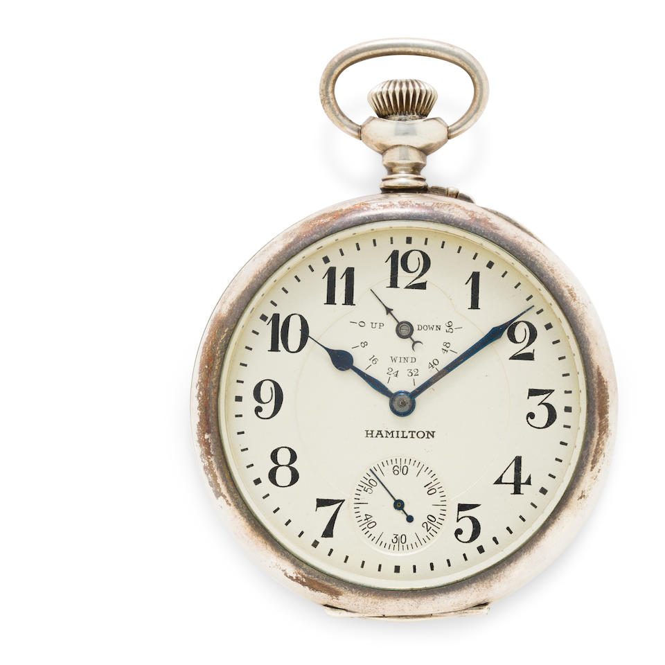 Hamilton. A fine and large silver open face deck watch with winding indicator and a mahogany deck boxNo. 1260484