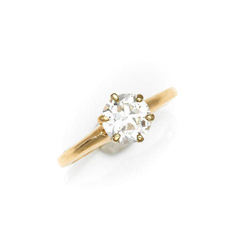 A diamond and 14k gold solitaire ring