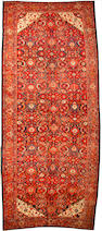 A Malayer long carpet  size approximately 7ft. 5in. x 17ft. 10in