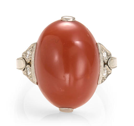 A late deco coral and diamond ring, circa 1935