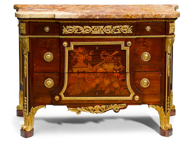 A Louis XVI style gilt bronze mounted marquetry inlaid commode