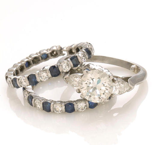 A diamond solitaire ring together with two sapphire and diamond eternity bands
