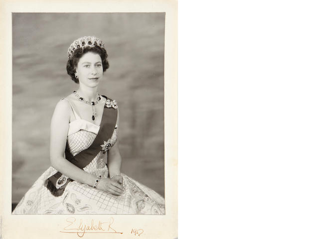 """BRITISH ROYAL FAMILY.  1. Photograph Signed (""""Elizabeth R"""") and dated 1952, seated portrait of Queen Elizabeth II wearing the crown jewels, in morocco picture frame with gilt royal monogram."""